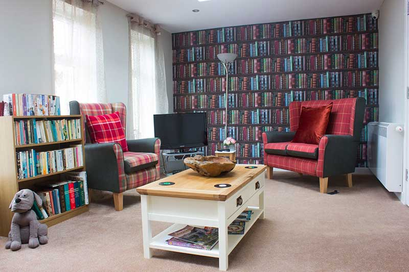 Reading room at High Brake care home in Lancashire