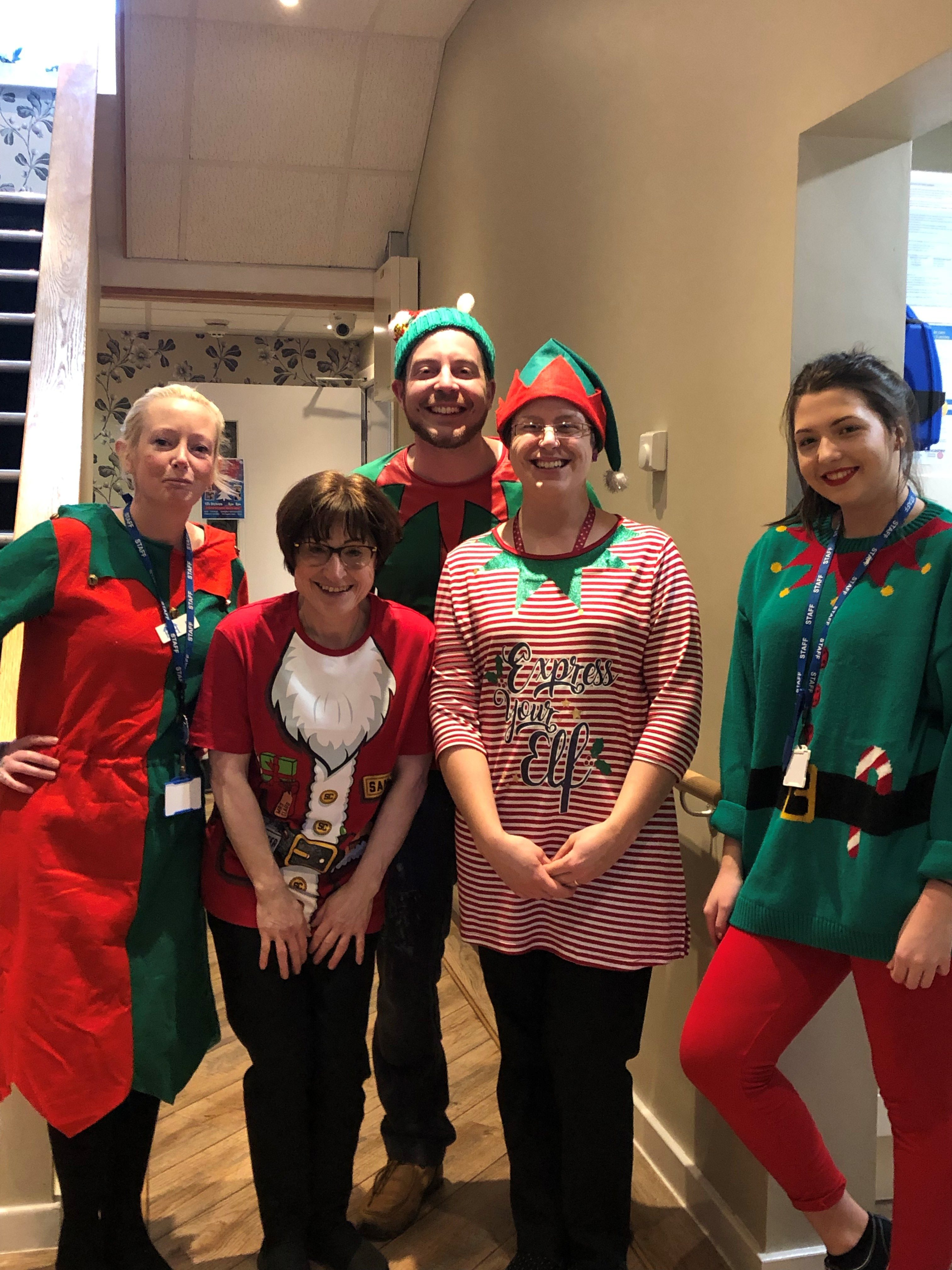 The staff dressed as Santa's little helpers.